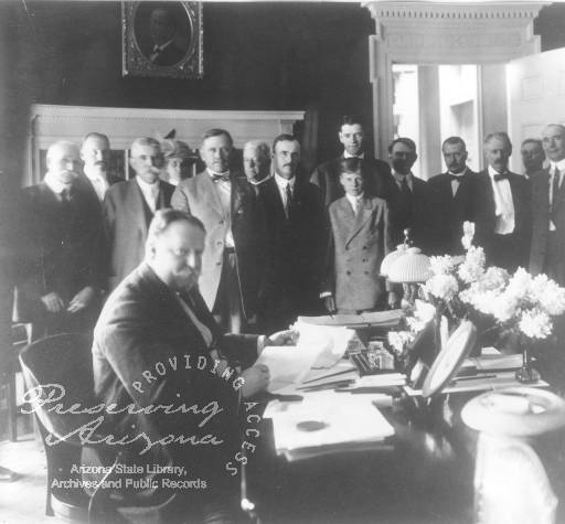 Photograph of President William Howard Taft signing the Arizona Statehood Bill