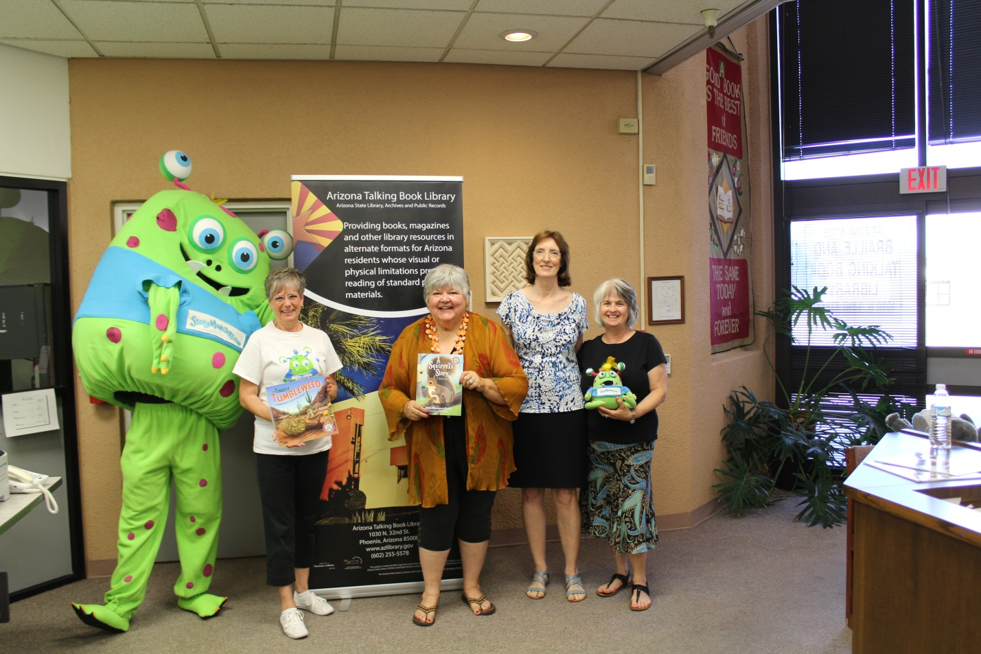 photo of Five Star Publications' Story Monster, authors Kathy Peach and Jana Bommersbach, Arizona Talking Book Library Administrator Janet Fisher and Librarian Vicki Rider