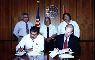 Members of Colorado River Indian Tribes signing gaming compact with Governor Symington