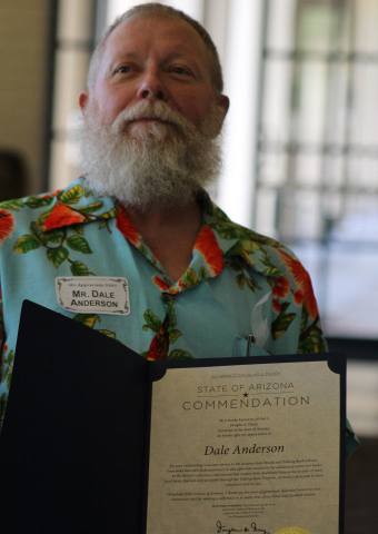 photo of Dale Anderson with commendation letter from Governor Ducey